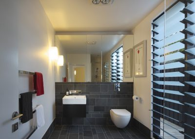 Bathroom with louvres on right