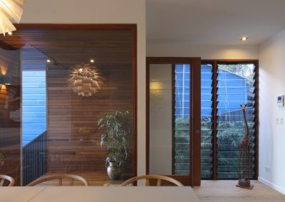 Dining room and looking out to garden through louvres