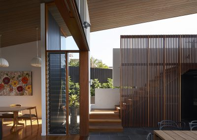 Tall narrow louvres look out onto backyard