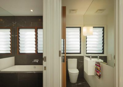 Bathroom and toilet with louvre windows to ventilate area