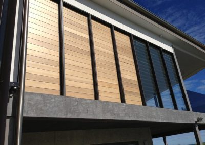 The Breezway Louvre Windows have timber blades to shade the home during the hot afternoon sun.