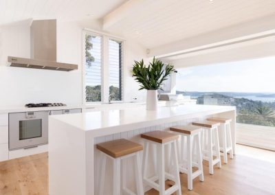 The kitchen uses louvre window to catch prevailing winds and give more ventilation control.