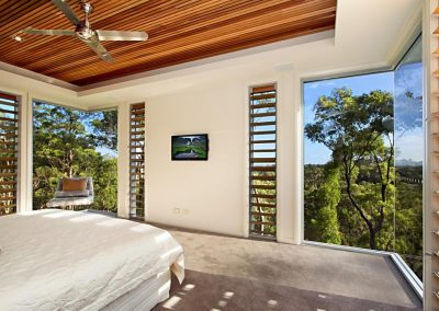 Louvre windows with timber blades become a feature in the bedroom