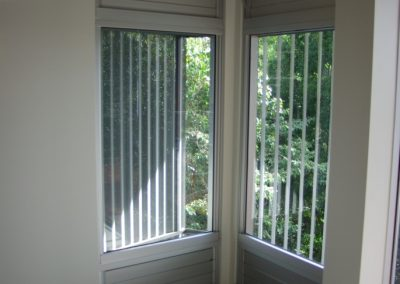 Louvre windows provide a hi-lite and lo-lite with fixed glass