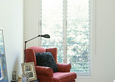 Comfortable chair beside 2 bay Breezway Louvre Window with 102mm glass blades