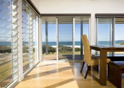 View of glass louvres from Breezway with ocean in background
