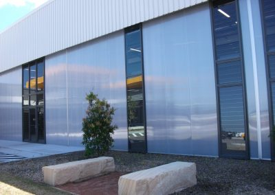 Powerlouvre windows have been installed in commercial framing and stacked to create tall high ventilation windows