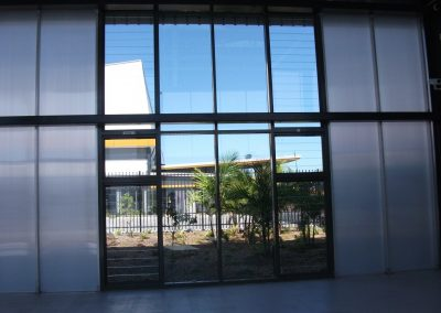 Louvre windows by Breezway in a commercial framing system