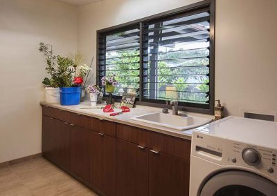 The laundry uses Breezway Louvre Windows to bring in fresh air and remove moisture.