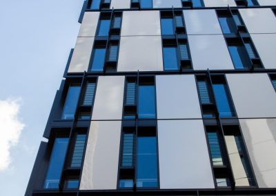 Iglu apartment windows use a combination of fixed glass and Altair Louvres with Stronghold for light and fresh air.