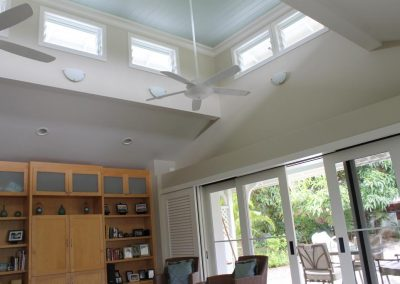 Louvres windows were installed up high to draw the hot air out of the home