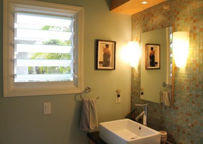 The renovated bathroom uses 152mm Altair Louvre Windows with obscure glass