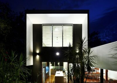 A three bay glass louvre window brings fresh breezes into the home