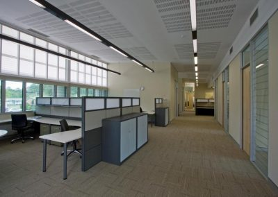 Interior view of office with Altair Powerlouvre windows to exterior wall and in office partition for internal ventilation control