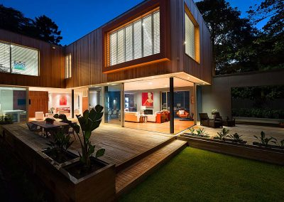 Outside dusk view of modern home with Breezway Louvre windows