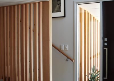 Louvres with timber blades have been used in bedrooms to help manage ventilation within the home