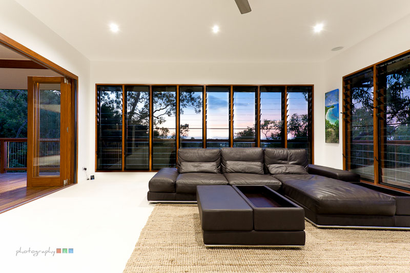 Lounge Room With Louvre Windows Providing Light And Breezes