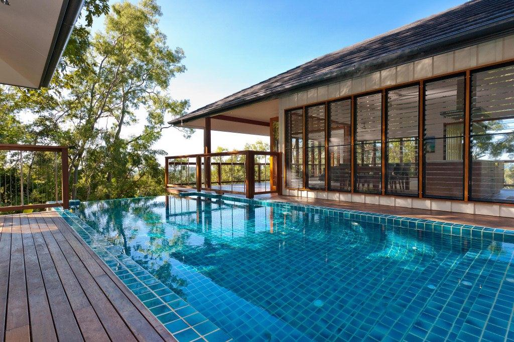 Pavilion style luxury pole home in cairns northern beaches for Pavillion home designs australia