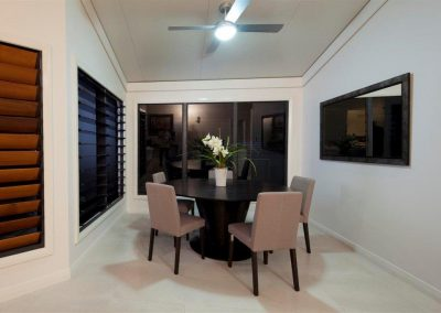 The dining area has a double glass louvre window and timber louvre to give plenty of fresh breezes