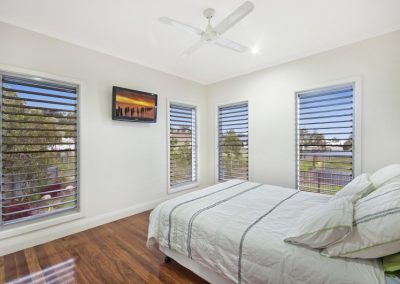 Plenty of louvre windows from Breezway make this bedroom light and airy.