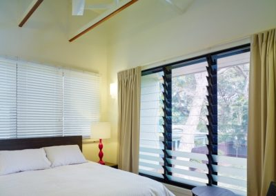 Bedroom with louvre windows with clear and obscure glass for privacy