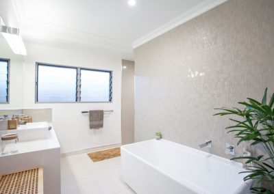 Guest bathroom has Louvre Windows with privacy glass