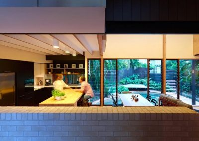 View to pool through Breezway louvres -Ashgrove Residence