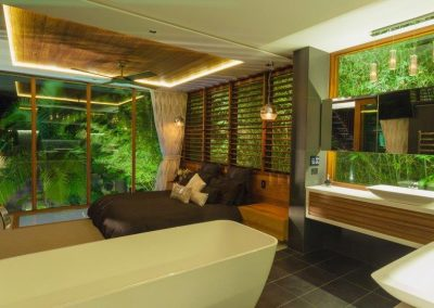 Multiple bays of timber louvres above the bed