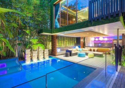 Outdoor view of entertaining area and bedroom above