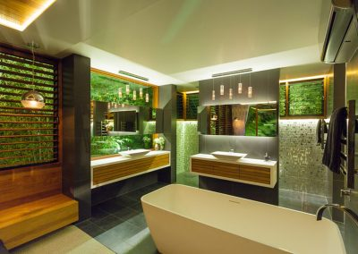 Timber and glass louvres in the bathroom for light and privacy
