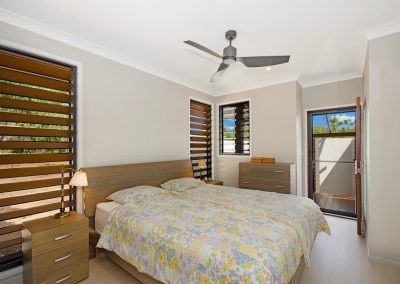 Timber louvres in bedroom for ventilation and privacy