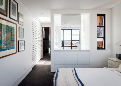 Bedroom with louvre windows on internal walls