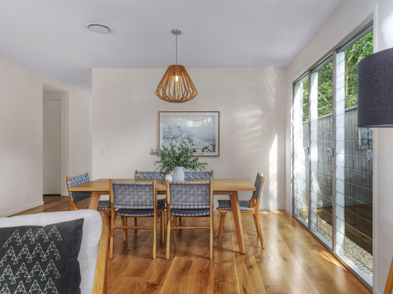 Dining room with wall of breezway louvres in kalka display home