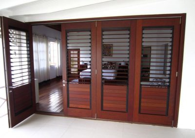 Breezway Louvre Windows with timber blades in bi-fold doors allow ventilation in even when the door is closed