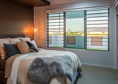 Breezway Louvres in a fixed lite combination help frame a view whilst still allowing plenty of air to circulate the bedroom