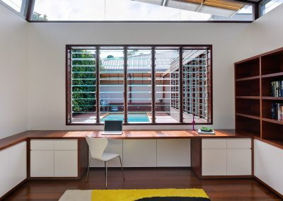 Breezway Louvres in study rooms with outdoor pool views
