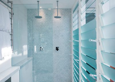 Breezway Louvres with satina blades are a popular choice for homeowners in shower rooms