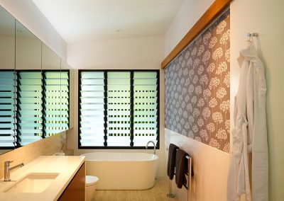Breezway Louvres with satina or satinlite glass maintain privacy in bathrooms while ventilating the space