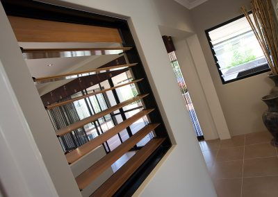 Breezway Louvres with timber blades on internal walls provide privacy and ventilation between rooms