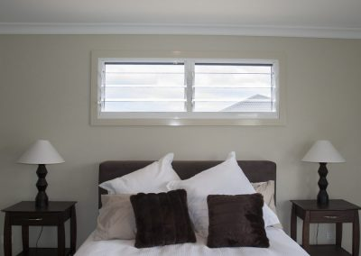 Position Breezway Louvres above a bed to provide ventilation and privacy at the same time