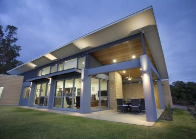 External view of Breezway louvres next to fixed lite glass and above sliding doors