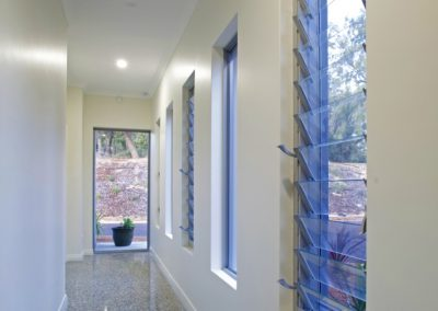 Hallway using tall narrow Breezway Louvres to ventilate the area