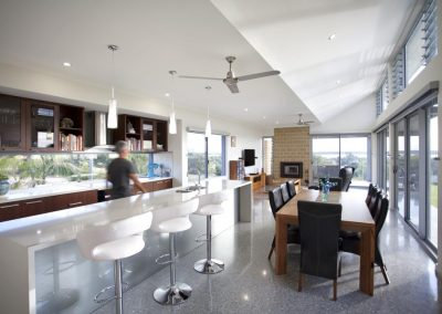 Kitchen and dining area with Breezway louvres above sliding doors