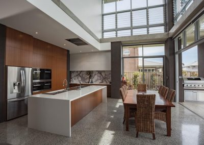 Kitchen and living areas brightened and naturally comfortable with Breezway Powerlouvres
