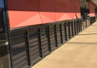Multiple Breezway Louvres with Security Bars in Carnes Hill Community Centre