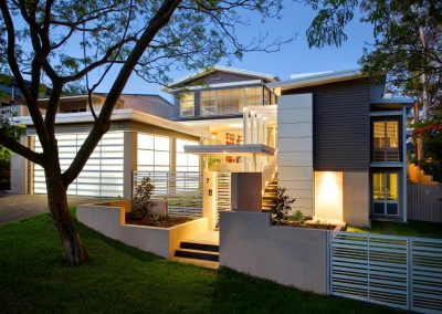 Front entrance of indooroopilly home with breezway louvre windows