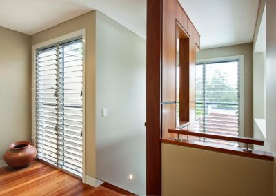 Multiple bays of breezway louvres in the staircase to help light and ventilate small areas
