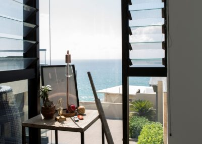 Views out onto ocean through breezway louvres