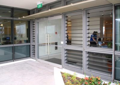 Louvres on either side of entrance doors