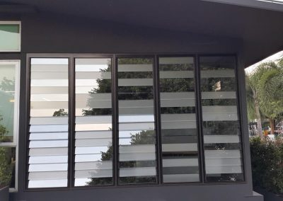 mix glass louvre blades provide decorative affect at thai aust office